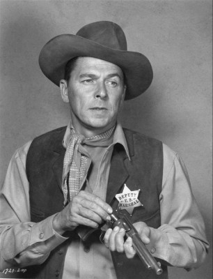 "** FILE** Actor Ronald Reagan loads his gun in the 1953 western film ""Law and Order"", in which Reagan plays a retired U.S. marshall who can't hang up his holster. It is reported that Reagan died on Saturday, June 5, 2004 at 93. (AP Photo)"