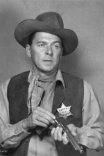 "**  FILE**  Actor Ronald Reagan loads his gun in the 1953 western film ""Law and Order"", in which Reagan plays a retired U.S. marshall who can't hang up his holster.  It is reported that Reagan died on Saturday, June 5, 2004 at 93"